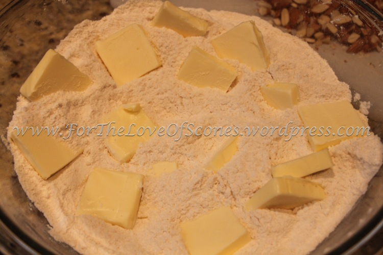 Add the chopped, chilled butter to the dry mixture.