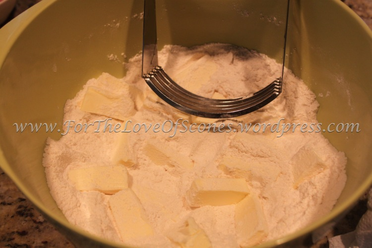 Add the chopped, chilled butter to the dry ingredients and work in with a pastry blender or your fingers. (I like to start with a pastry blender and then finish up with my fingertips.)