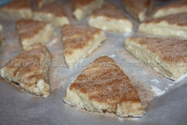 Press the sprinkled sugar lightly into the raw dough and spread the scones out to 1- to 2-inches apart.