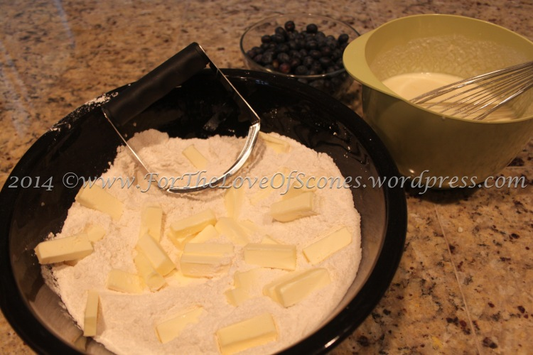 Add the cold, chopped butter to the dry ingredients and mix with a pastry blender.