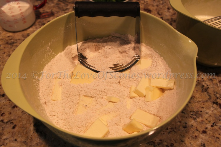Add the butter to the dry ingredients and blend with a pastry blender.