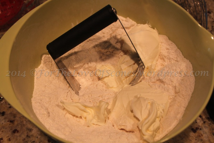 Add the 8 oz mascarpone to the mixture and work in with a pastry blender until uniform.