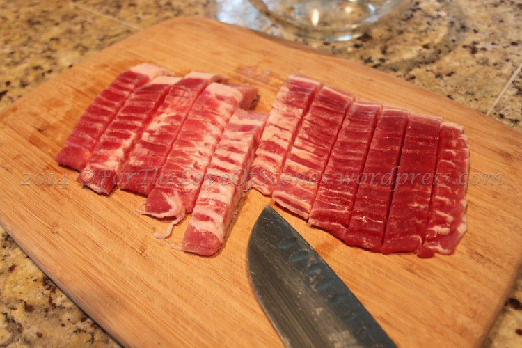 Mostly frozen bacon dices quite nicely. Just toss the frozen strips onto a hot skillet and cook to your desired crispiness!