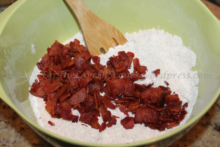 Add the bacon to the dry ingredients and mix with a wooden spoon.