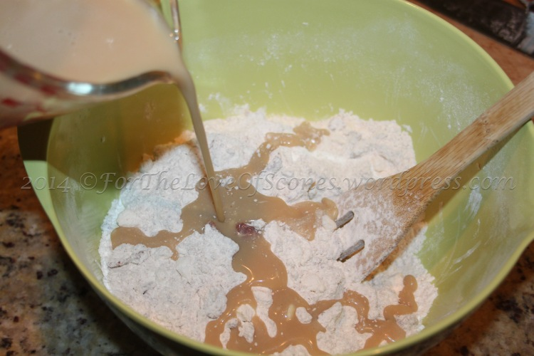 Add the maple syrup mixture to the dry ingredients and stir with a wooden spoon to mix.