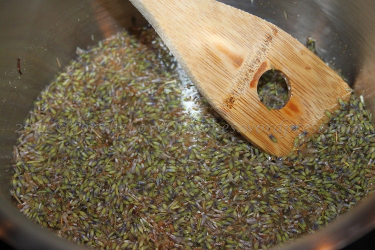 Simple syrup begins: allow the water and lavender flowers to simmer for several minutes before adding the sugar.