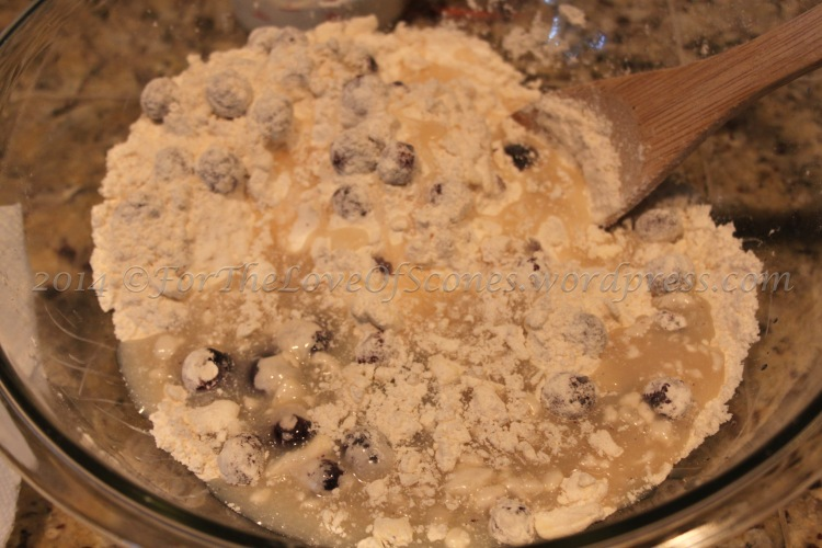 Add the honey, syrup, half & half mixture to the dry ingredients and stir with a wooden spoon. This should bring you almost to scone dough consistency.
